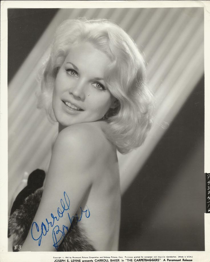 BAKER CARROLL: (1931-     ) American Actress, an Academy Award nominee. An appealing image of the blonde bombshell in a head and shoulders pose in costume as Rina Marlowe Cord from The Carpetbaggers (1964). A pencil annotation to the verso in the hand of a collector indicates that the autograph was obtained in person on 10th June 1976 when Baker attended a performance of The Norman Conquests at the Morosco Theatre in New York.
