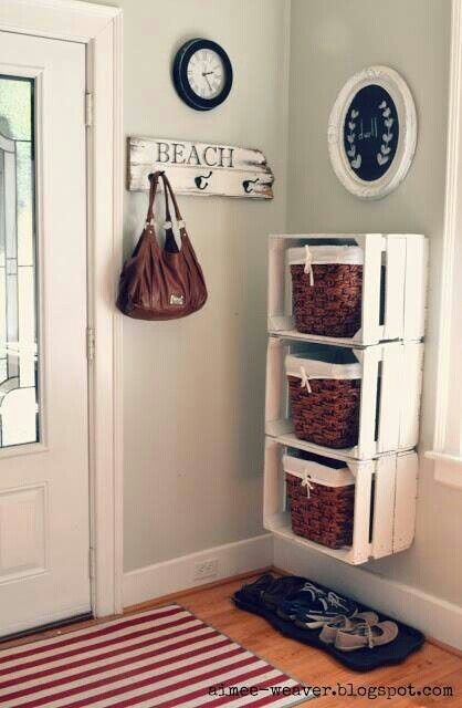 Entryway organization idea using wooden crates & baskets