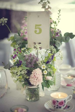Pride and Prejudice. Wedding reception decor. Table numbers. Floral centerpieces.