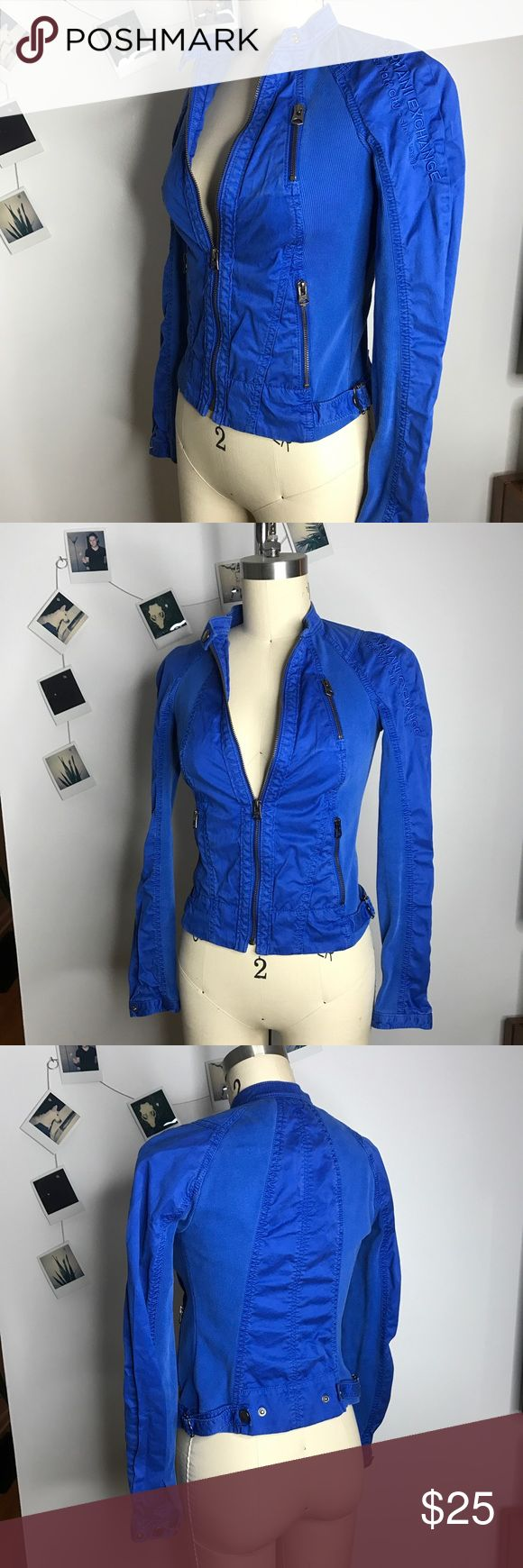 Electric Blue Armani Exchange Jacket Amazing accent piece for any wardrobe. This electric blue jacket has embroidered details, raglan type sleeves, and lots of zippers. It has elastic on sides and arms for an extra slim fit. Put it over a slip dress for an edge. Armani Exchange Jackets & Coats Utility Jackets