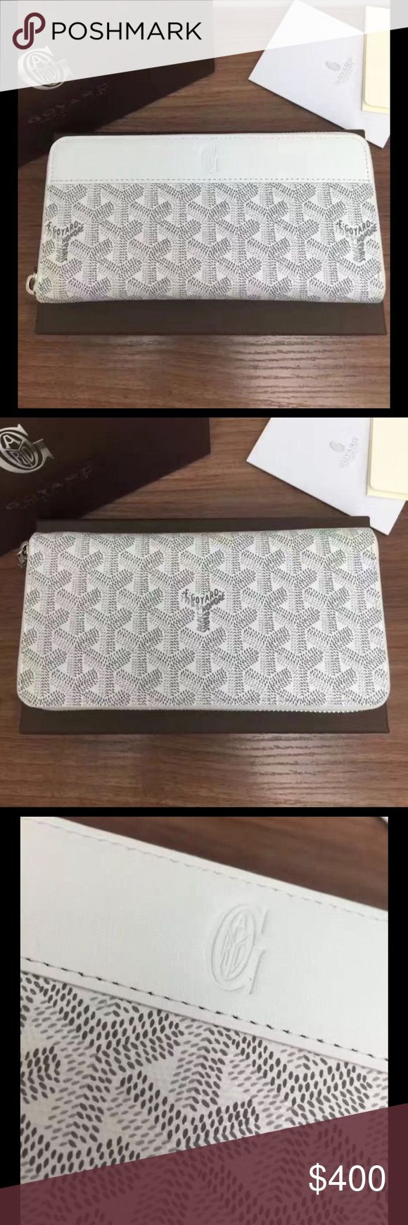 Goyard coin purse bi-fold wallet women's 100% authentic Goyard coin purse wallet. Comes with box. Used 2 times. Gorgeous white painted canvas and yellow leather interior. Please allow up to 10 days for handling. Open to reasonable offers. Please inquire about discounted pricing! Please ask any questions. Thanks and have a great day :) Goyard Accessories Key & Card Holders