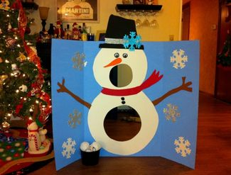 Snowball toss game. Great for cold winter days or a new years party with kids.