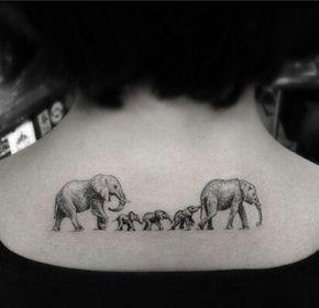 PERFECT! This is what I want for my tattoo!!! @ big elephants for Big-Ken and I and 2 baby elphants for Kendrick and Keithen!! But the daddy elephant in from of the mommy invade we have more kids! And I want it on my ribs. (Right below where a sports bra would stop)