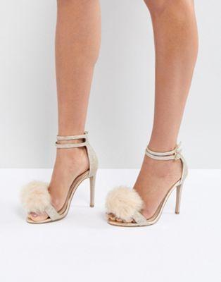 cb560b36b Carvela Glenn Gold Faux Fur Pom Heeled Sandals in 2019