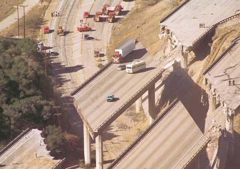 Jan 1994: Home to millions of people, the LA, CA, region is underlain by numerous active faults, many of which cannot be seen at the surface. One of these hidden faults produced the Northridge earthquake, which caused 57 deaths/ wide-spread damage—photo shows vehicles stranded by the collapse of sections of I-5. Photo: Brant Ward; copyright SF Chronicle