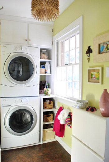 stacked front-load washer & dryer...hmmm maybe? definitely provides additonal room in a small laundry  pic from Young House Love