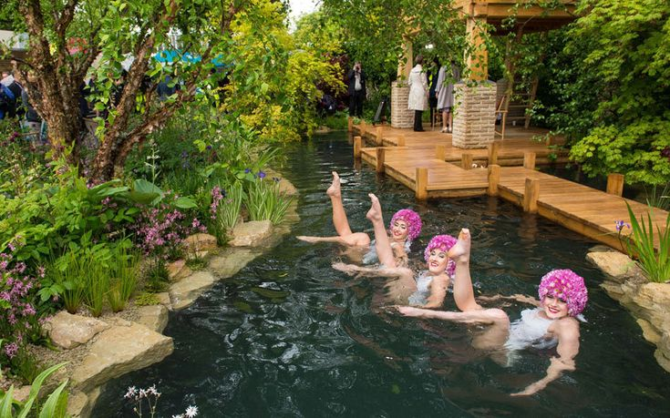 RHS Chelsea Flower Show 2015:Synchronised swimmers perform in a pond at the M&G Retreat garden