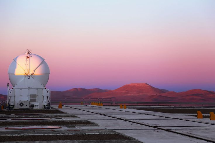 Armazones and an Auxiliary Telescope. One of the four 1.8-metre Auxiliary Telescopes atop Cerro Paranal admires Cerro Armazones — the future home of the European Extremely Large Telescope