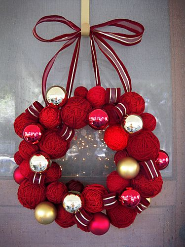 Nice job! Love the combination of shades of red yarn balls with pops of pink, gold, and silver ornaments. #yarn #wreath