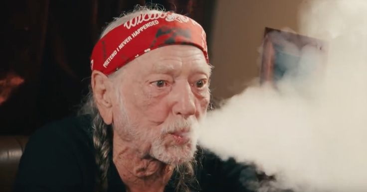Watch Willie Nelson blow smoke at Jimmy Fallon when the 'Tonight Show' host visits Nelson's tour bus.