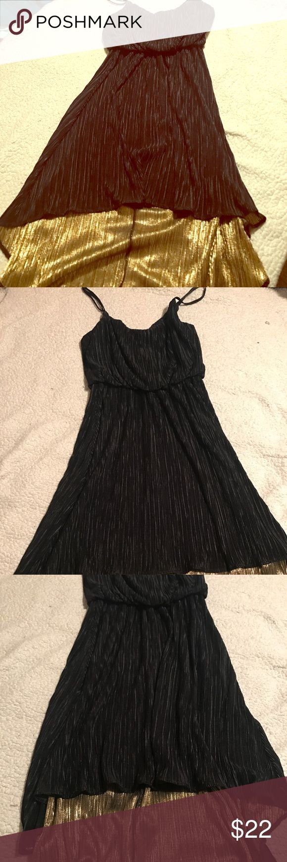 Black and Gold 70s-esque Party Dress Channel disco vibes with this super fun LBD with a flash of fun. Ruched, almost pleated fabric and a High-low hem shows off the for gold lining. Spaghetti straps and forgiving silhouette! Never worn. Dresses High Low