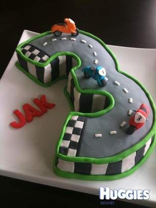 I created this for a wee friend of may daugters on his 3rd Birthday.  He is motorbike crazy and requested a motorbike racetrack complete with FAST motorbikes.   I shaped the cake in the number three. Moulded all the deocrations and motorbikes from fondant.