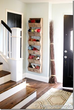 Wall storage bin - perfect in a small entryway, especially when trying to keep shoes off the carpet.
