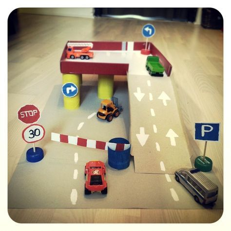 Cardboard parking garage, kids, cars
