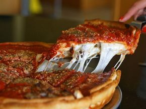 Deep dish pizza is as accurately named as any food I know. Even if you've never experienced one in person, you already know to expect something imposing and thick, with generous layers of sauce and cheese. But which pizzeria in Chicago serves the best? I tried 13 different places to find out.