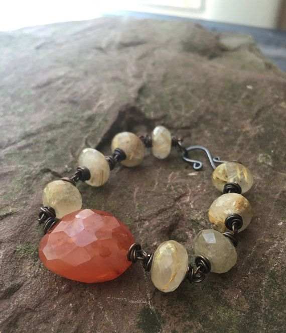 Hey, I found this really awesome Etsy listing at https://www.etsy.com/listing/462450071/carnelian-and-rutilated-quartz-bracelet