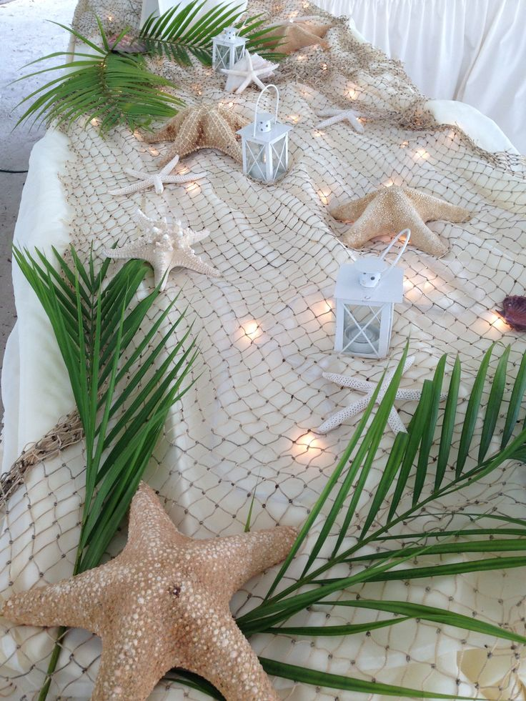 diy beach theme wedding centerpieces%0A Starfish island buffett table decor    Luau Party DecorationsBeach