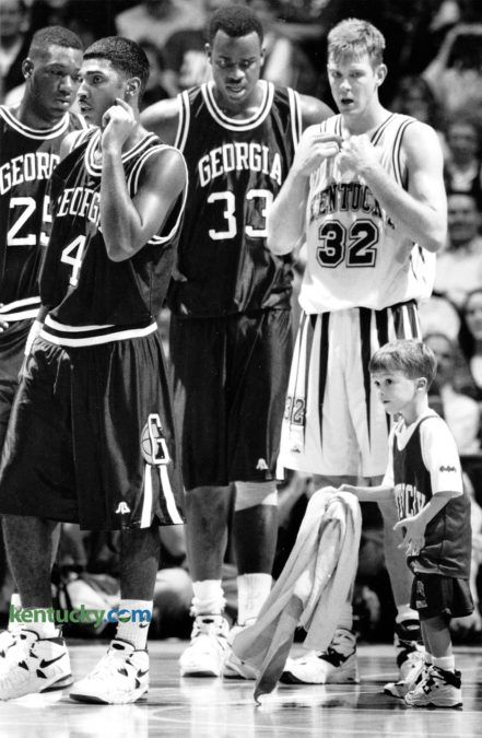 Ryan Pitino, Kentucky Coach Rick Pitino's 4-year-old son, was put to work during the UK-Georgia basketball game January 14, 1995, helping keep the Rupp Arena floor dry. Photo by Frank Anderson | staff