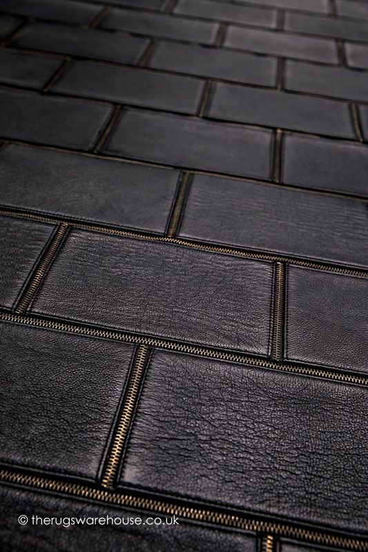 Rockchic Rug (texture close up), a visually stunning designer black leather & brass zippers rug (designed by Papilio Design House in Belgium, available in 2 sizes) http://www.therugswarehouse.co.uk/rockchic-rug.html #rugs #designerrugs #luxury