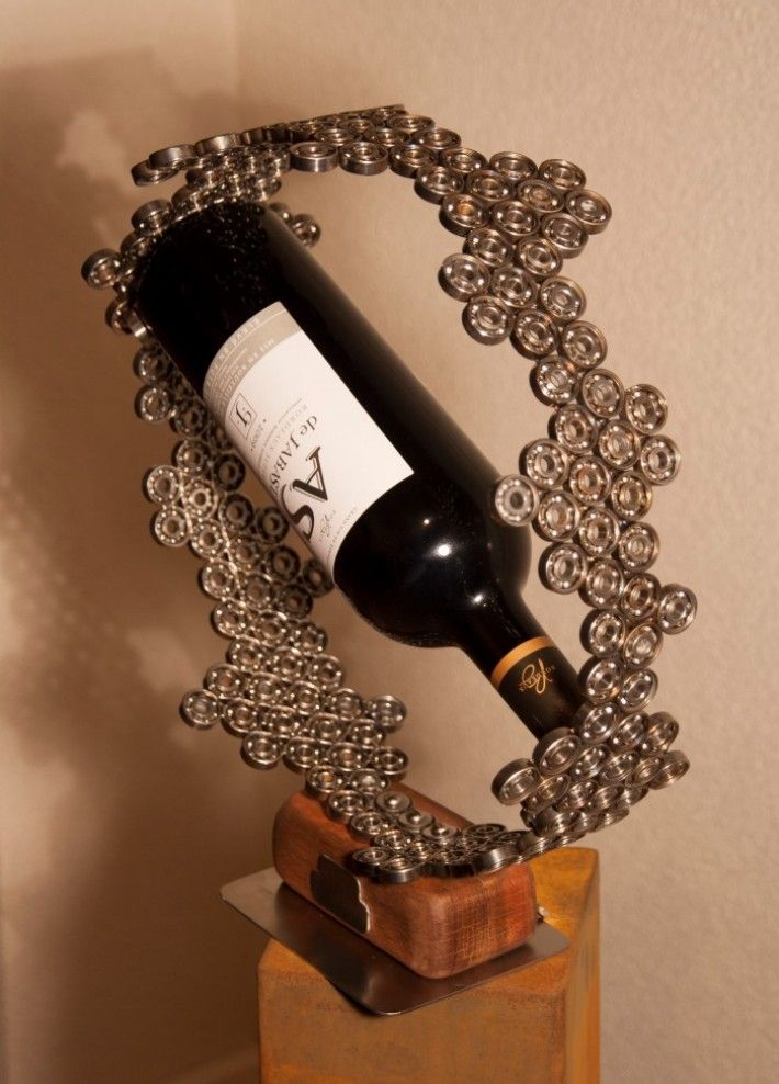 Custom made wine holder, was auctioned for charity project. Made of welded parts of 'garbage' out of a working factory.