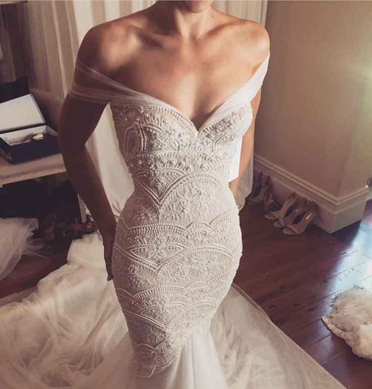 This off the shoulder couture wedding gown has very ornate and detailed embellishments on teh fit-to-flare bodice.  many haute couture #weddingdresses like this can be out of a brides price range.  So as custom dressmakers we can upon request make an #inspiredweddingdress that is based on a couture design to look very similar and have the same style but will cost much less.  Get pricing and see how it works when you visit us at www.dariuscordell.com