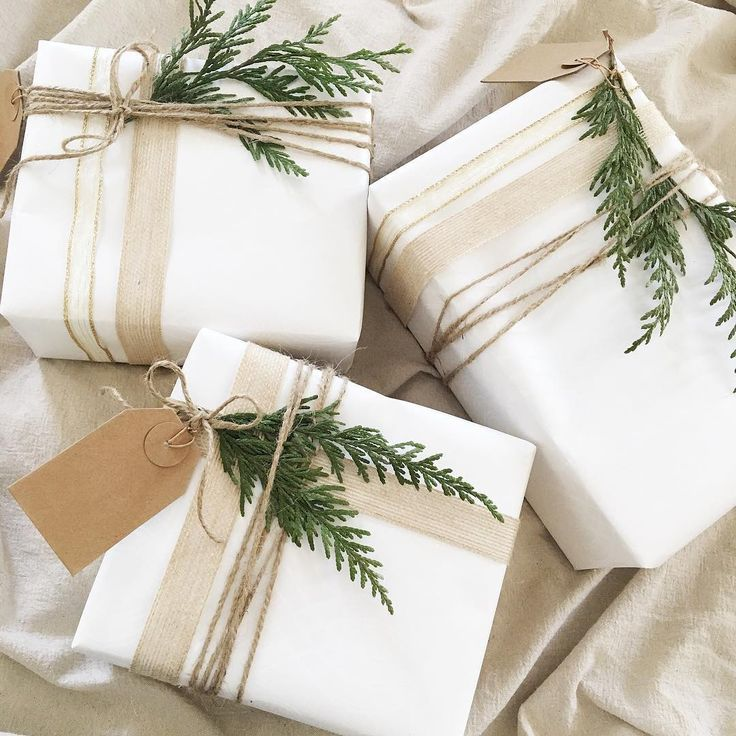 Our love of sophisticated neutrals extends to gift wrap! Textured twine and ribbon and an accent of greenery makes for presents that will look stylish under the tree. Photo: @this.fair.lady #Holiday #HolidayParty #Holidays #Entertaining #EntertainingAtHome #Hostess #HolidayGift  #HolidayStyle #HolidaySeason #HolidaySpirit