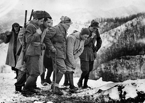 A group of Italian soldiers study a map spread on a snow-covered dugout near a front line mountain peak in Italy. This advanced Italian post is co-operating with the Allies in holding off the invading Nazi army during World War II. Pin by Paolo Marzioli