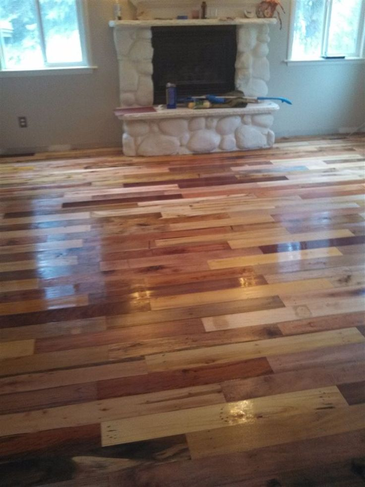 floor made from pallet boards that had the nails taken out and then machined.
