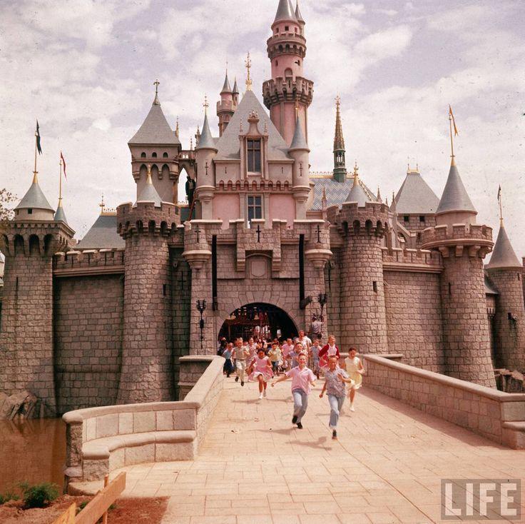 Children Run through Sleeping Beauty Castle on Disneyland's Opening Day, 1955.