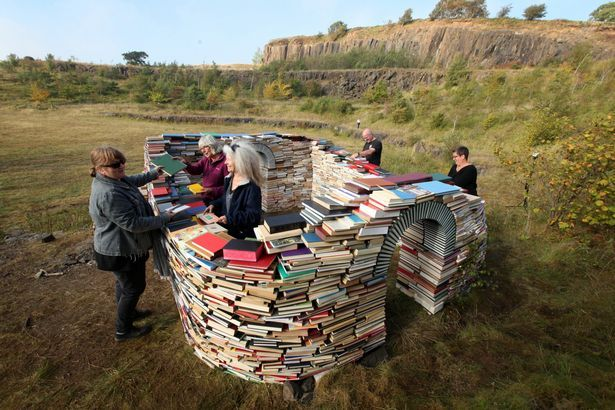 Artist Dawn Felicia Knox, with her work at Walltown Quarry, a Milecastle made from books on Hadrians Wall