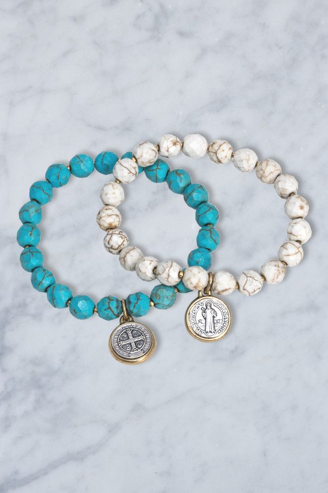 Viva Italia! Our St. Benedict charms come straight from the source in Italy. Wear alone or with other bracelets. These are stretchy, so sizing isn't an issue. Available in either blue or white turquoi
