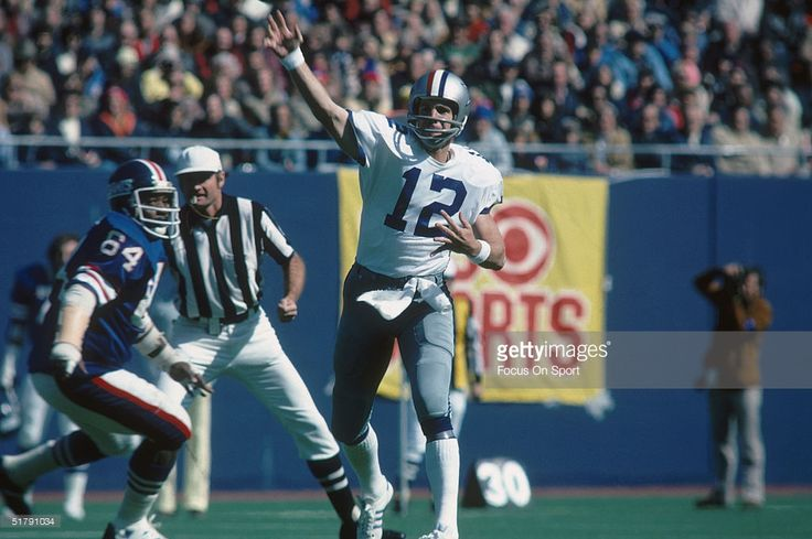 Dallas Cowboys quarterback Roger Staubach #12 throws a pass during a game against the New York Giants, 1970