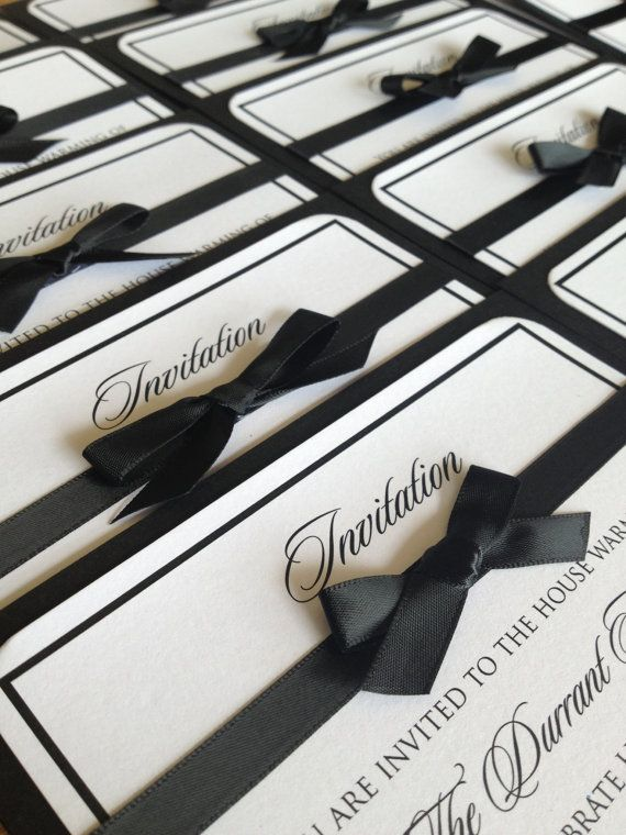 Classic black and white wedding invitation...but with a royal blue ribbon.