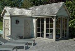 Pool house, abris de piscine réalisés en chêne et patiné. la toiture est faite en bardeaux de cèdre. Lasne - Brabant Wallon