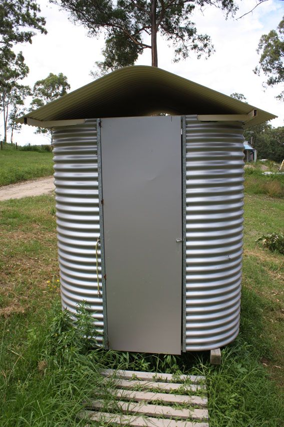 """Outhouse -- Australian Outhouse made from curved corrugated Iron.  Also known as an """"Aussie Dunny""""."""