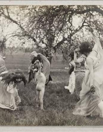 A beautiful silverscreen image of Isadora Duncan dancing with children in a field. Self expressionism