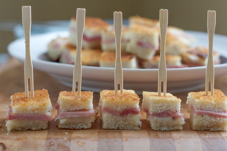 Mini Croques Monsieur Sandwiches.. a traditional French ham and cheese sandwich, made in bite sized form! The easiest and tastiest appetizer ever!