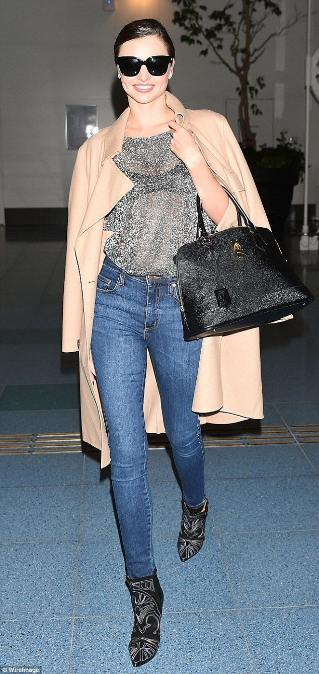Sheer delight!Miranda Kerr flashed her black bra in a sheer sparkly top as she strutted through Haneda Airport in Tokyo, Japan on Friday    4      1