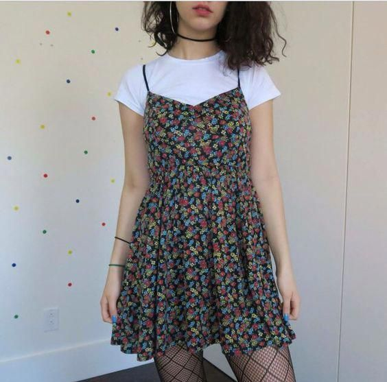 T-shirts and dresses were in in the 90's. #grungeoutfits90s