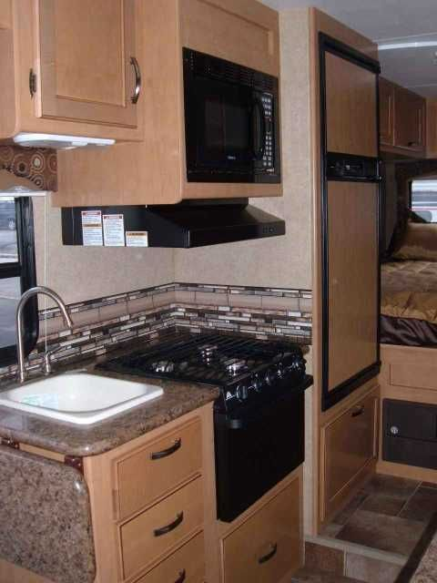 """2015 New Thor Motor Coach FOUR WINDS 22E Class C in Pennsylvania PA.Recreational Vehicle, rv, Sleeps up to 6 with 3 sleeping areas: rear 54""""X80"""" corner queen bed, 54""""X87"""" over cab queen bed, and 40""""X68"""" U-shaped booth dinette conversion. Seats 6 (5 seat belts). Ford E-350 chassis, 6.8L V10 gasoline engine, with automatic transmission with overdrive, tilt steering, cruise control, power windows & locks, driver & passenger air bags, touchscreen AM/FM dash radio with DVD/CD player and…"""