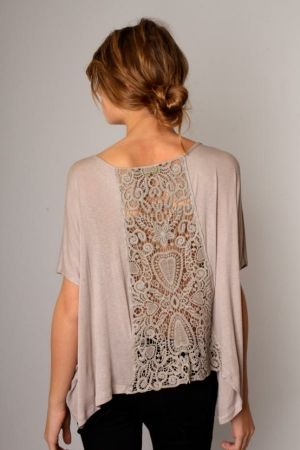 Add a crochet doily panel to a top.