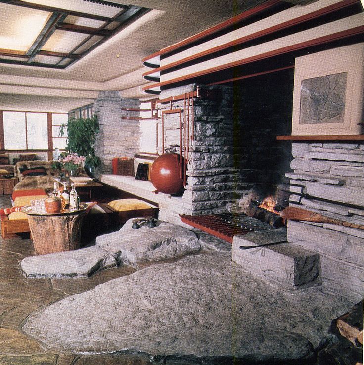 Flr fallingwater fireplace and rock in front fallingwater interioralpine housefalling watersfrank lloyd wrightmodern interiorscontourmidcentury