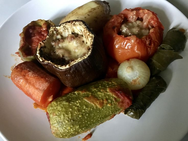 Stuffed vegetables and tomatoes with minced meat and pine nuts. Topped with cheese, baked in tomato sauce.