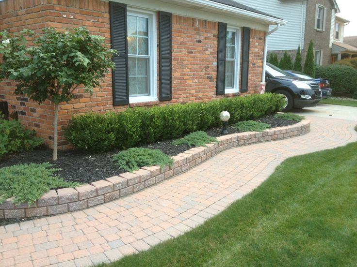 paver walkway with paver wall and nice landscaping