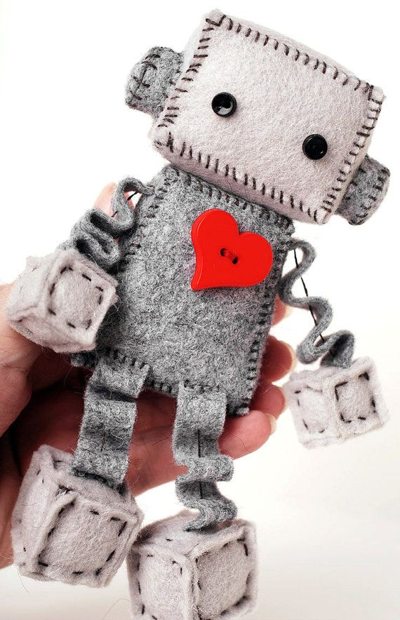 Make your own little robot plush. The DIY kit contains the supplies you need to make one little felt robot with a big red heart. It is helpful if you have some experience hand sewing, but none is necessary. The kit also makes a darling gift for those that like to DIY their own crafts and plushies. Your finished robot will be about 4 inches tall sitting.  Robot kit contains: *Wool Felt in two shades of gray (this is the good stuff) *Thread in dark gray, red and black *Black buttons for eyes…