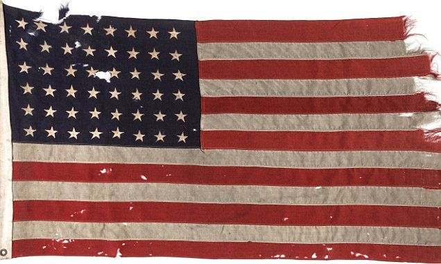 """#DailyMailUK .... """"The flag has been kept by US Navy Lieutenant Howard Van Der Beek.. It was carried by troops on to Utah Beach during WWII on June 6, 1944.. The 48-star flag was flown from the stern of Landing Craft Control 60.. The torn and tattered flag that is replete with a bullet hole from a German machine gun is expected to fetch as much as $100,000 in the auction.""""…"""