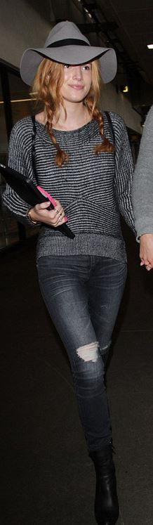 Who made Bella Thorne's gold jewelry, black stripe sweater, and gray skinny jeans?