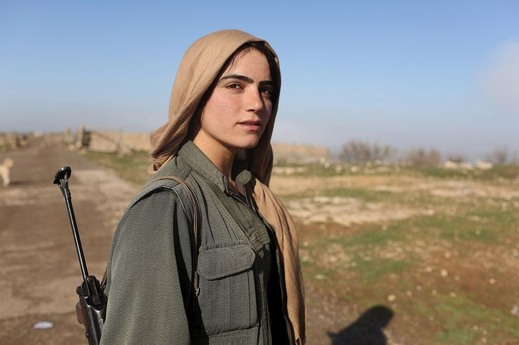 A female fighter of the Kurdistan Workers' Party stands guard at a PKK base on Mount Sinjar, in Sinjar, Kurdistan. (Photo Credit: Asmaa Waguih)