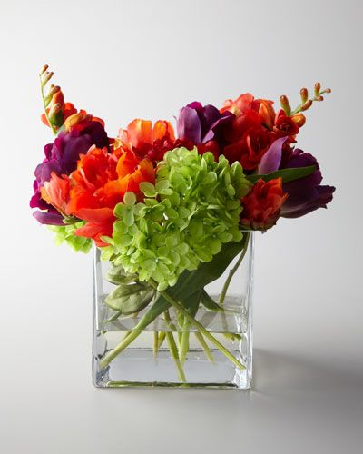 Faux floral arrangement enlivens your desk, kitchen window, bedside table, or anywhere you need a burst of color. From John-Richard Collection.
