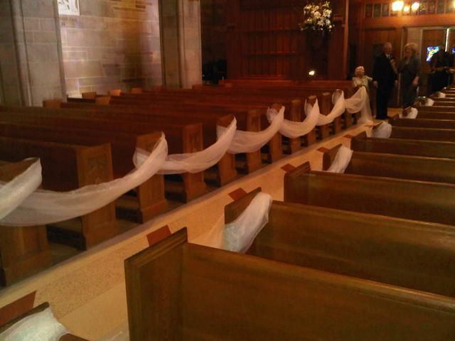 I like this - if we do it inside - to block off all the pews we won't need for our uber small wedding